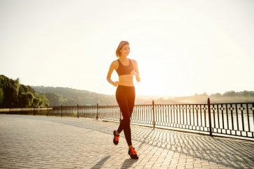 running-woman-runner-jogging-sunny-bright-light-female-fitness-model-training-outside-park_158595-1304